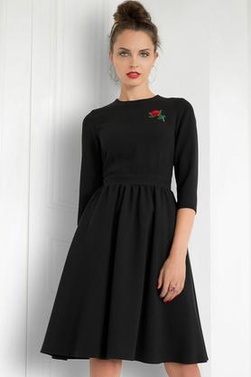 Sukienka rozkloszowana czarna z różą PROJEKTANT Kasia Miciak