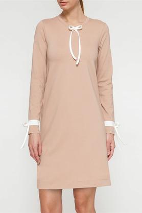 Sukienka z białymi kokardkami beżowa PROJEKTANT Yuliya Babich