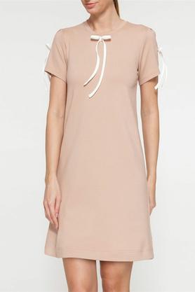 Sukienka z kokardami beżowa PROJEKTANT Yuliya Babich